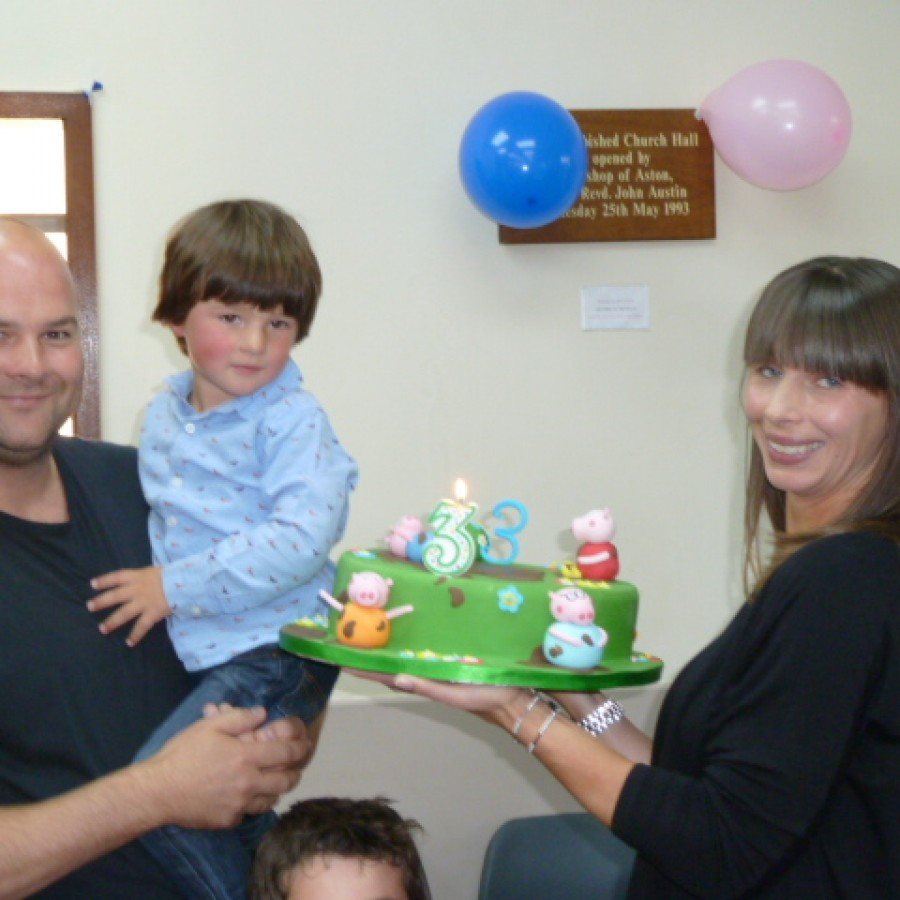 Happy family with magic bob comedy magic show and doing the birthday cake